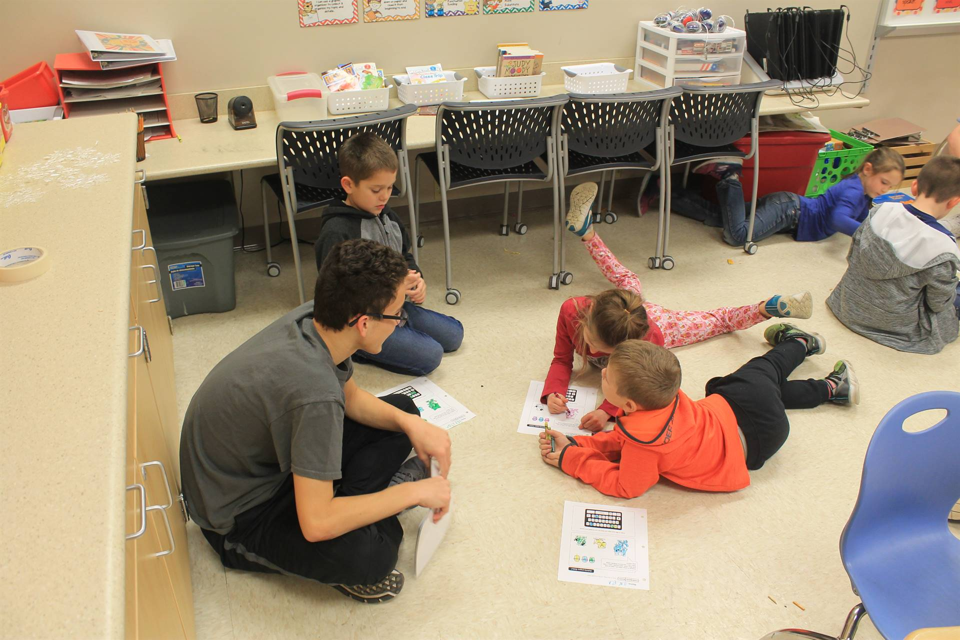 Second Grade Students Reading with High School Students